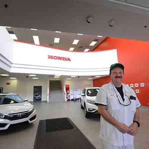 Image of a man in the Honda show room