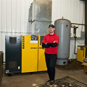 Image of a man standing by machinery