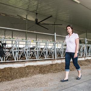 Image of a woman walking through Kie Farms