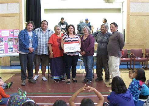 Image of a Powerplay cheque presentation in a First Nations community