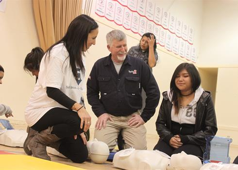 Image of a Hydro One employee teaching CPR to high school students