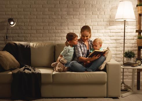 Image of a mother reading to her two children