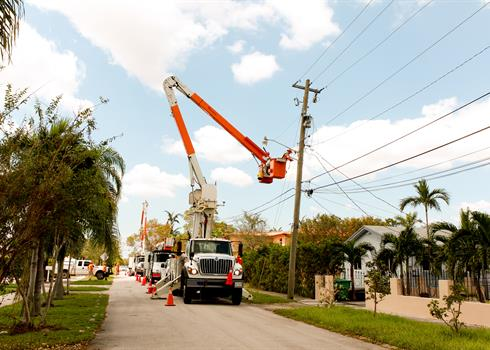 photo of a Hydro One truck restoring power on a heavily damaged Florida street