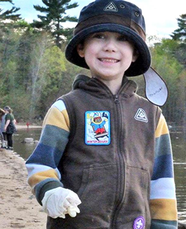 a young boy in a Scouts uniform