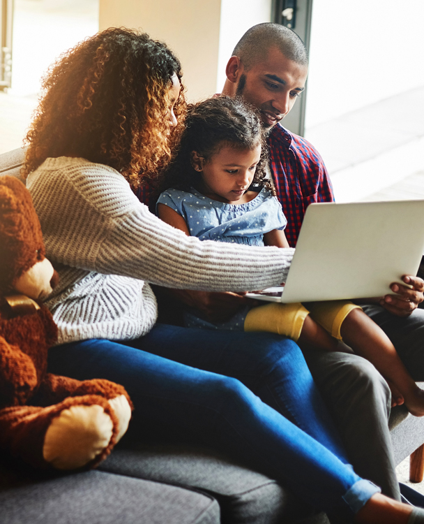 photo of a family using a laptop