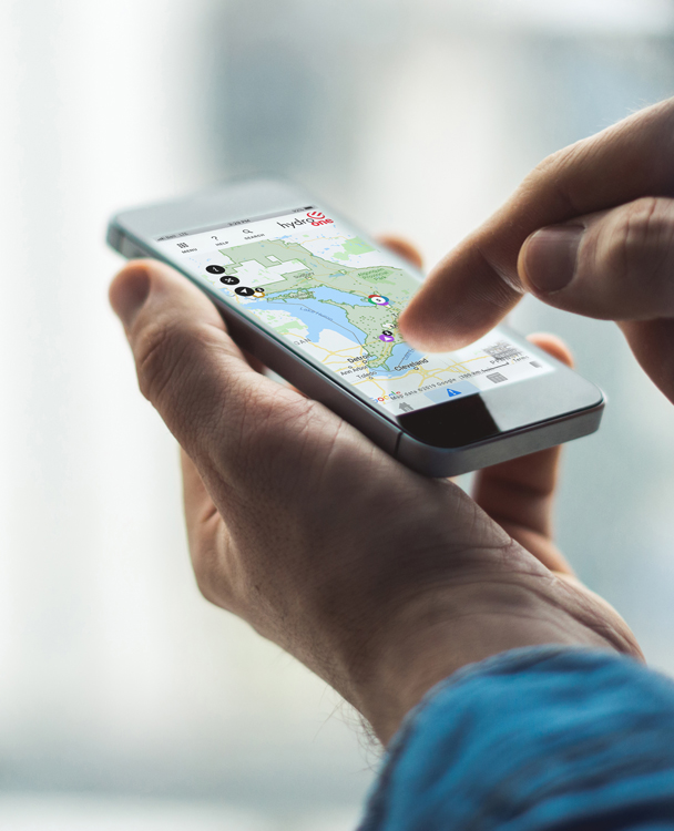 photo of a hand holding a mobile device running the Hydro One mobile app
