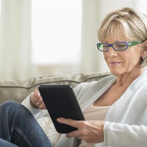 image of a woman using a tablet computer