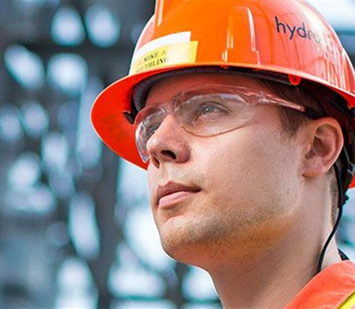 photo of a Hydro One worker wearing a hard hat