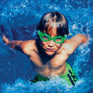 Image of a boy in a pool wearing goggles