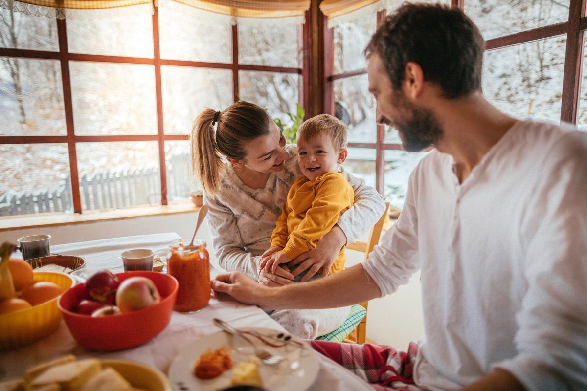 Family enjoying breakfast in winter.