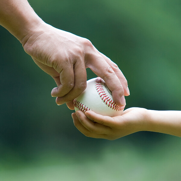 Handing baseball over to other hand